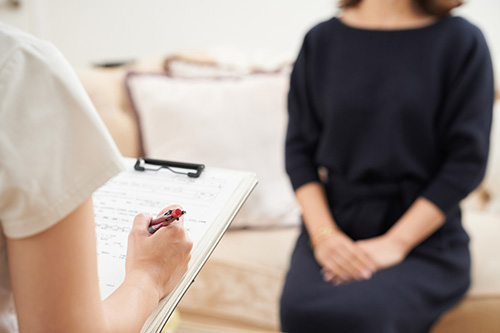 A woman the doctors asking questions about her colonoscopy