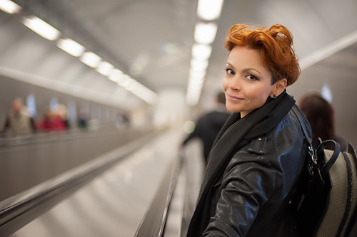 Woman on escalator with concerns about her bone health and hormonal health
