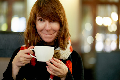Woman drinking tea for the many health benefits