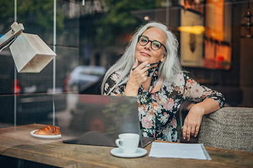 woman in cafe concerned about her irregular periods