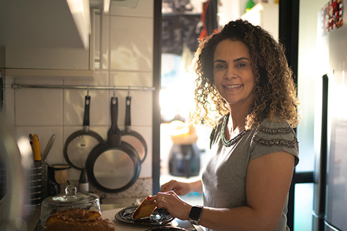 Woman in kitchen thinking about the best way to get off prempro and switch to natural hormonal support