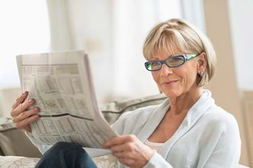 A woman reading the latest studies on menopause and women's health