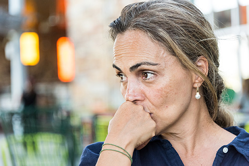 A woman is stressed about gaining weight in perimenopause