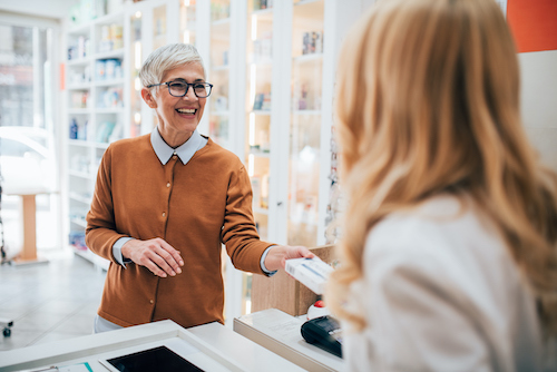 Woman at compounding pharmacy who is worried she lives too far away to pick up HRT prescription