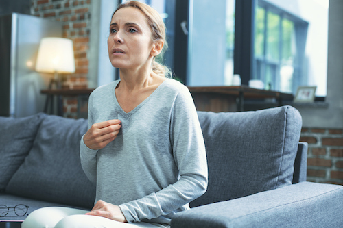 A woman thinks about which herbs and natural remedies work for hot flash relief