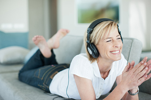 Woman listening to a podcast about her options for hormone replacement therapy and natural options for boosting low libido