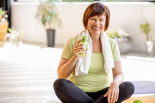 A happy woman who has found relief from chronic UTIs