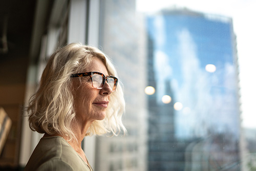A woman thinking about the risks of bio identical hormone replacement therapy