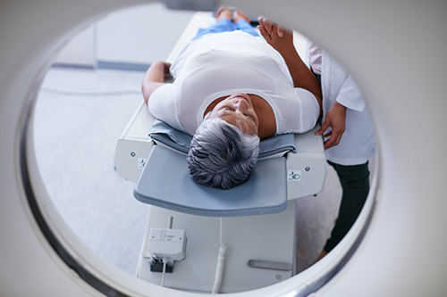 Woman getting MRI guided uterine ablation