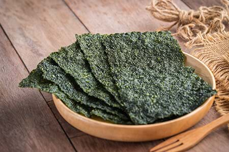 crispy seaweed on wooden plate