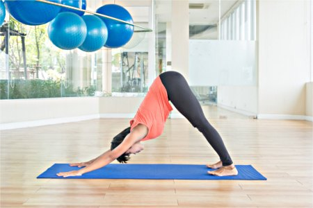 Women in downward facing dog yoga pose