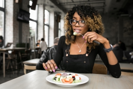 woman eating and worrying about her digestion