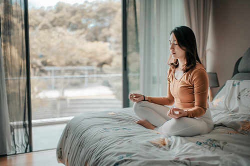 Woman learning to meditate