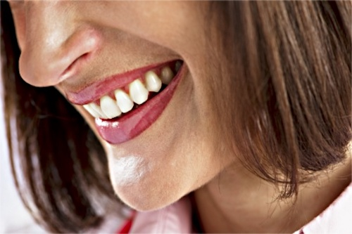 Gum disease, marked by bleeding and irritated gums, can be a symptom of hormonal imbalance