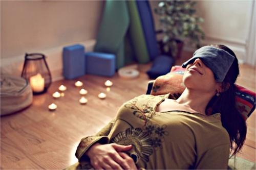 A woman practicing restorative yoga