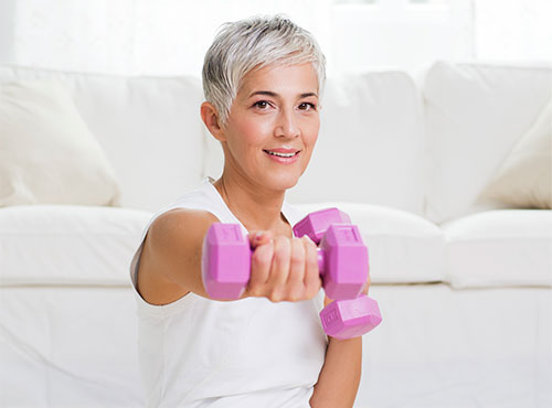 A woman using exercise to ease her arthritis