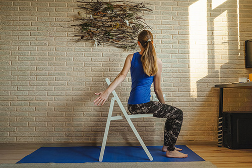 Woman in a chair practicing yoga