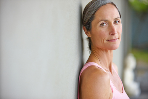 women in pink thinking about breast cancer risk from taking HRT