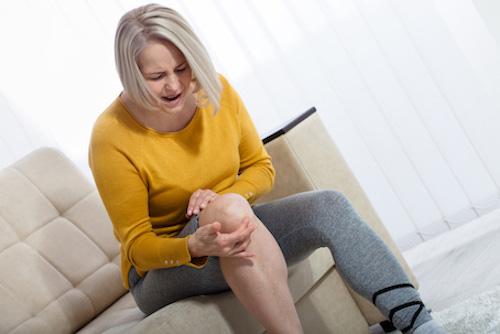 Woman having knee arthritis pain