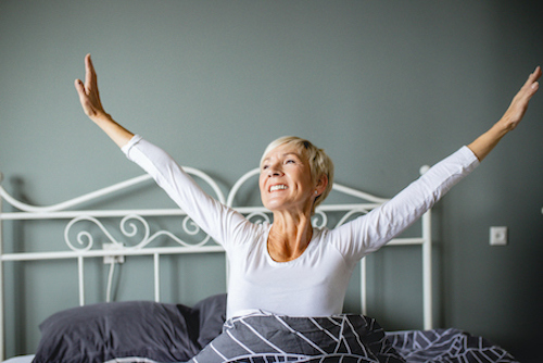 A woman using melatonin to boost her immune system