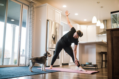 A woman doing yoga to lower her high blood pressure