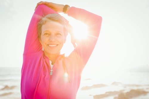 A woman taking vitamin D for her health