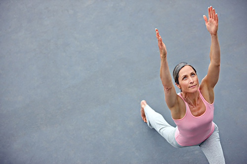 A woman concerned about hormonal bone loss doing yoga