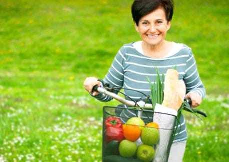 older woman with healthy groceries