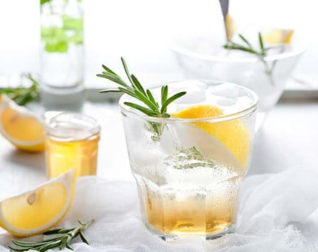 healthy sparkling water with lemon rosemary and honey