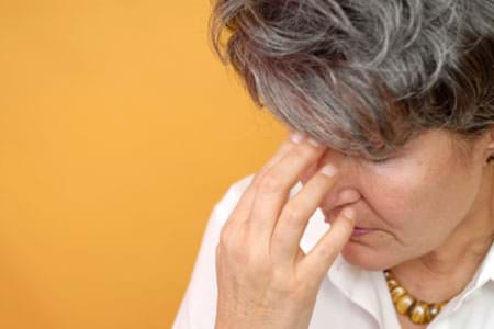 woman experiencing hormonal imbalance and irritability in perimenopause