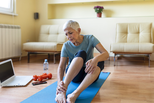 A woman with joint pain looking for natural relief