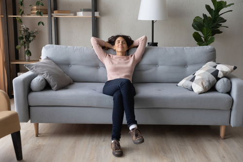 woman relaxed on sofa
