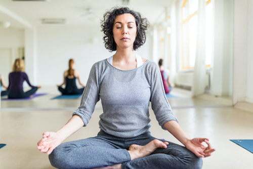 Woman managing her stress with meditation.