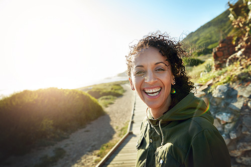 A woman outdoors exercising to reduce inflammation