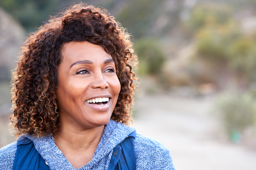 Woman happy to be knowledgeable about low bone density.