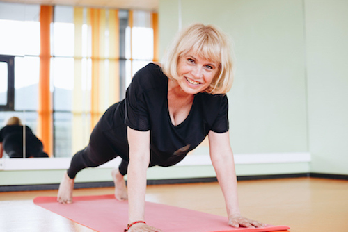 Woman in menopause exercising to improve bone and muscle mass.