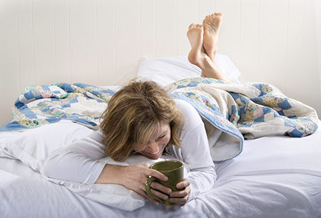 A woman looking for natural treatments and tips to relieve her fatigue and insomnia
